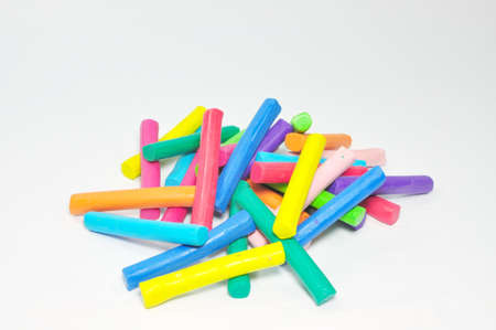 Bulk of colorful plasticine stick stand on white background photo