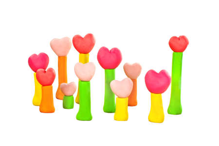 group of sweet color heart on post made from plasticine photo