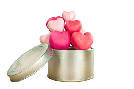 Tin can full filled with heart made from plasticine in sweety color photo