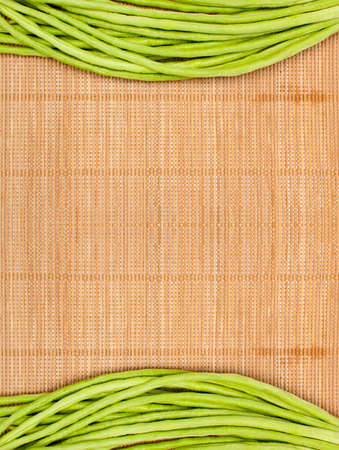 abstract design background vegetables on a wooden bamboo matbackground photo