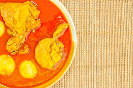 Most delicious spicy Thai food, Chicken curry (Mussaman curry) on bamboo mat background photo