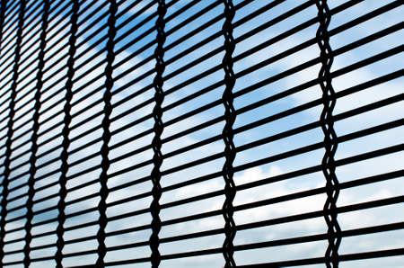 metallic net with sky background Stock Photo - 15214562