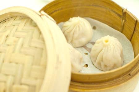 Chinese Dim sum in bamboo basket photo