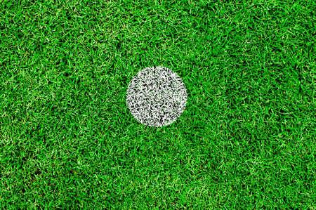 The white spot on a football pitch,center spot,penalty spot photo