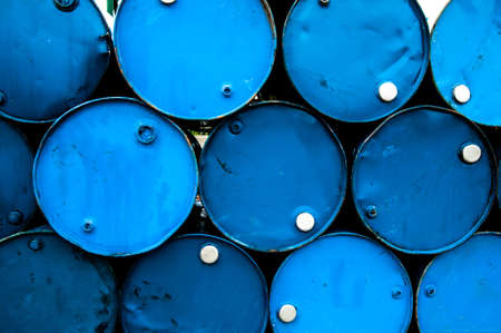 oil barrels or chemical drums stacked up Stock Photo