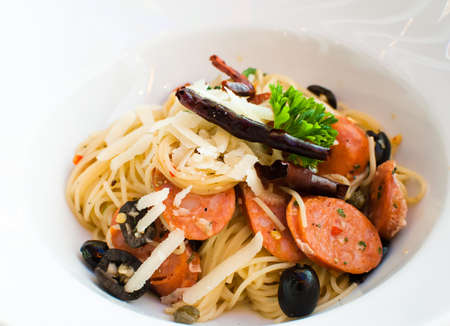 tasty hot and spicy spaghetti with thai sausage photo