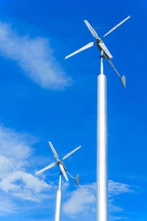 regenerating: wind turbine on cloudy blue sky
