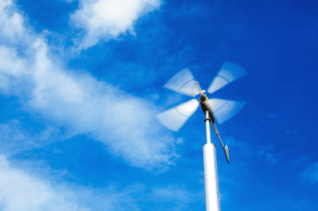 ecologically: wind turbine on cloudy blue sky