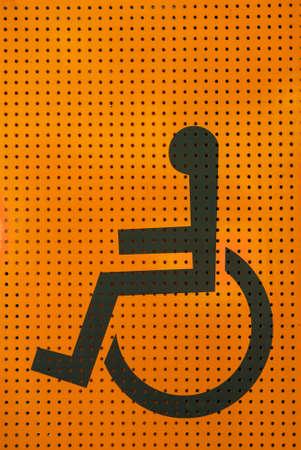 grating: sign disabled icon on orange grating metal