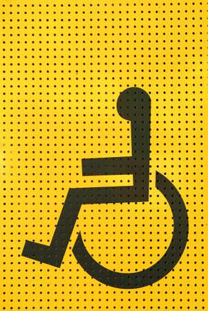 grating: sign disabled icon on yellow grating metal Stock Photo