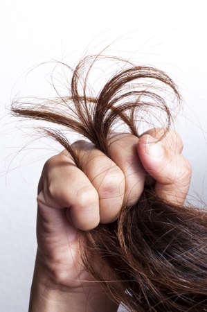 Woman hand grabbed damaged hair