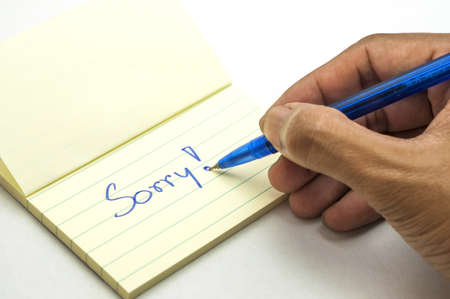 forgiving: a handwritten notes with sorry message