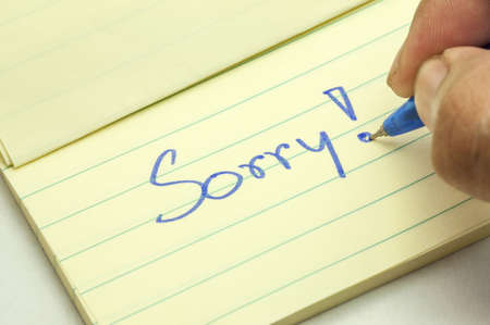 condolence: a handwritten notes with sorry message
