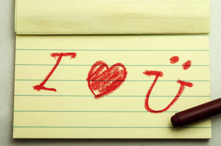 Hand writing love note with crayon