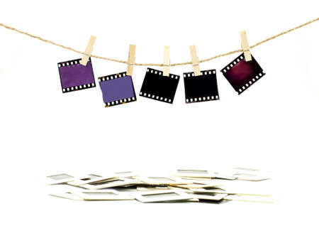 instant film transfer: Color film  hanging on rope with white background