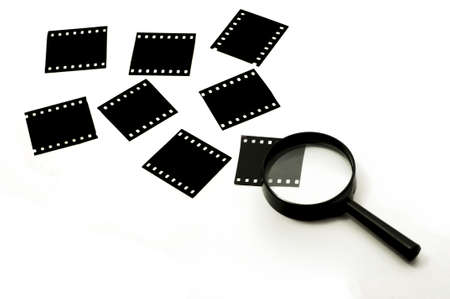 Slide film and magnifier glass,concept Stock Photo - 15686942