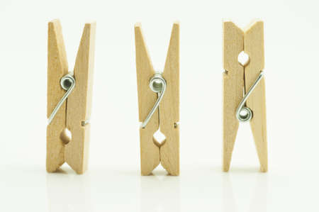 clothes pins: wooden clothes pin on white background Stock Photo
