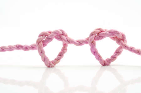 pink rope heart shaped symbol, isolated on a white background Stock Photo - 15751448