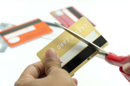 credit crunch: cutting up credit card with scissors Stock Photo