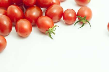 cherry tomatoes: photo of very fresh tomatoes presented on white background