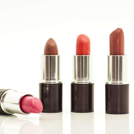 co lour: Lipsticks on white background Stock Photo