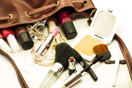full face: woman leather bag with cosmetics , tools and brushes Stock Photo