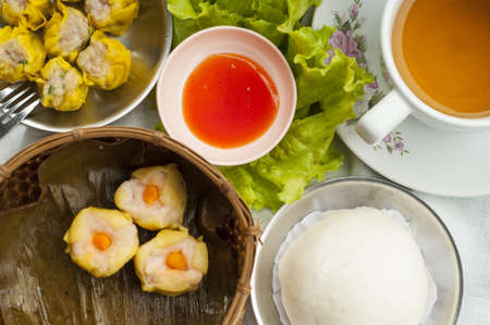 Dim sum, Chinese steamed pork , shrimp dumplings and steamed buns photo