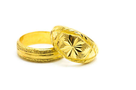 jewelle: artistic hand made gold rings with grunge texture on white background.