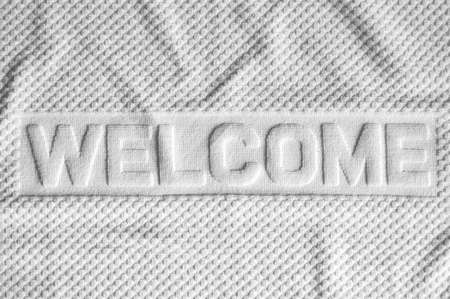 white towels: White welcome mat made from fabric Stock Photo