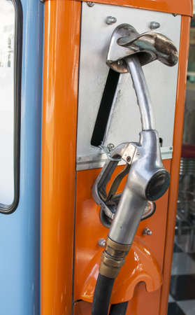 refuel: Vintage refuel hose on retro gas station Stock Photo