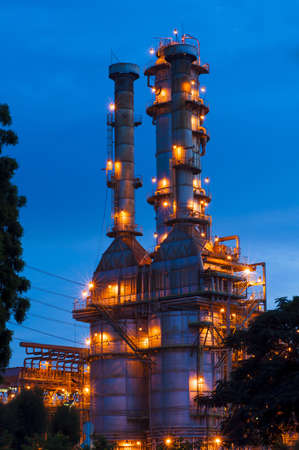 Oil refinery at twilight with blue sky photo