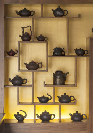 teapot in wooden chinese style built-in showcase Stock Photo