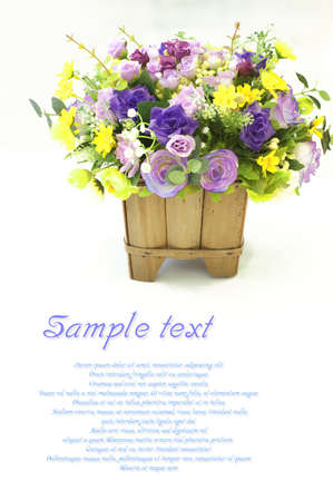 beautiful bouquet of bright flowers in basket, on white background photo