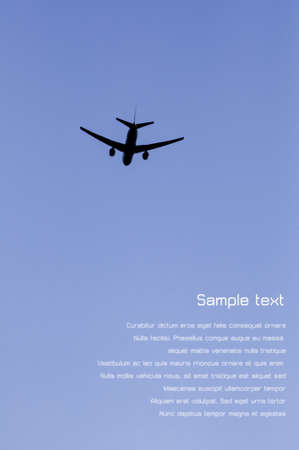 Silhouette of an airplane taking off into bright blue sky, with copyspace for text photo