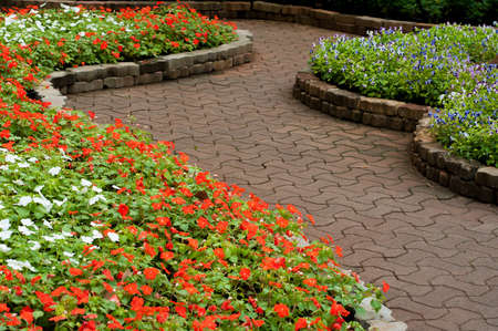 retaining: stone walkway in flower garden Stock Photo