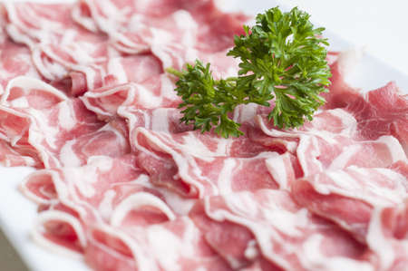 Sliced lamb meat on plate for shabu  photo