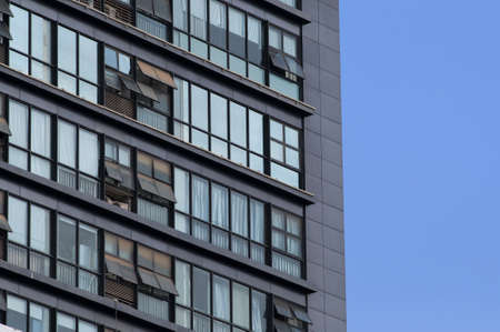 unclear: High building window with red dust