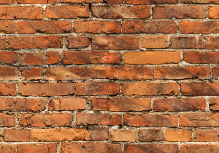 Seamless orange brick wall photo