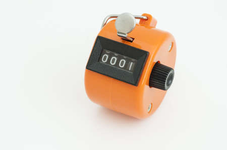 tally: Orange Hand tally counter, counting machine isolated on white bcakground
