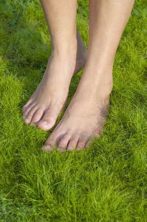 Barefoot walking on softness grass