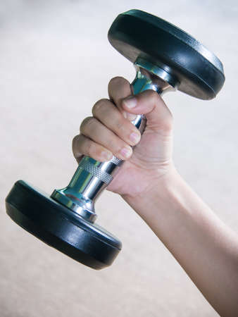 woman hand with heavy dumbbell  Stock Photo