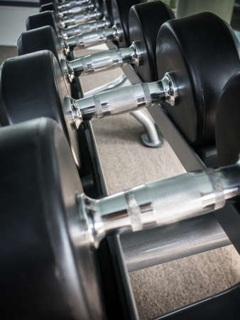 Dumbbell on rack in the gym photo