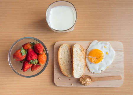 Home breakfast on wooden table photo