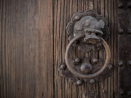 welcome door: Old Chinese style lion ring bell on wooden door