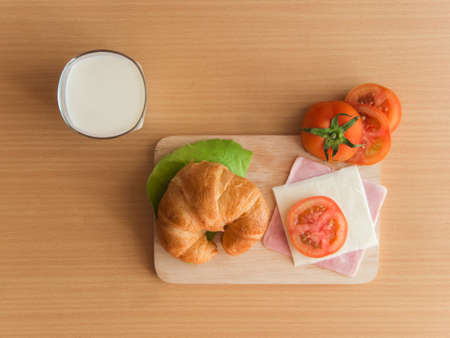Home breakfast ,Croissant ham cheese with milk photo