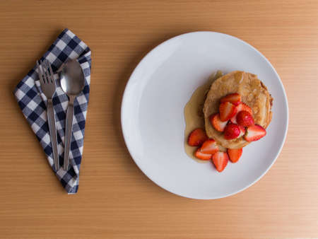 Homemade pancake with strawberry and honey syrup photo