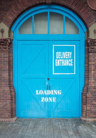 Blue Barn Door With Delivery Entrance And Loading Zone Sign Stock Photo    28263041