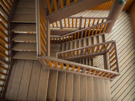 Wooden staircase in building (high angle view) photo