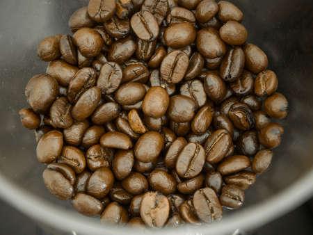 blackly: Detail of coffee bean in grinder