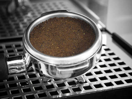 Grounded espresso in a portafilter photo